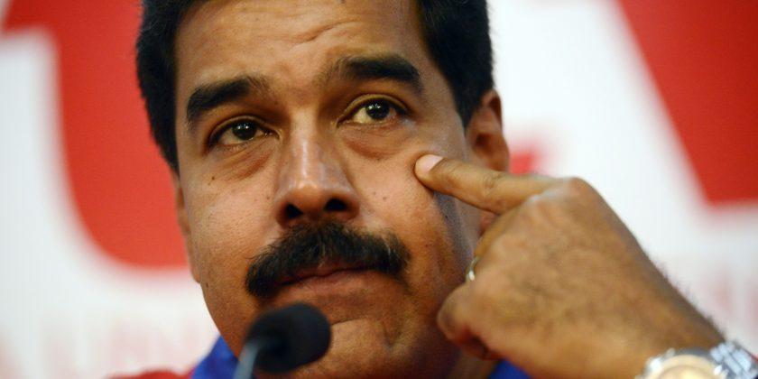 Venezuelan President Nicolas Maduro gestures as he speaks during a press conference at Venezuela's Socialist Party (PSUV) headquarters in Caracas, on October 21, 2013. AFP PHOTO/Leo RAMIREZ        (Photo credit should read LEO RAMIREZ/AFP/Getty Images)